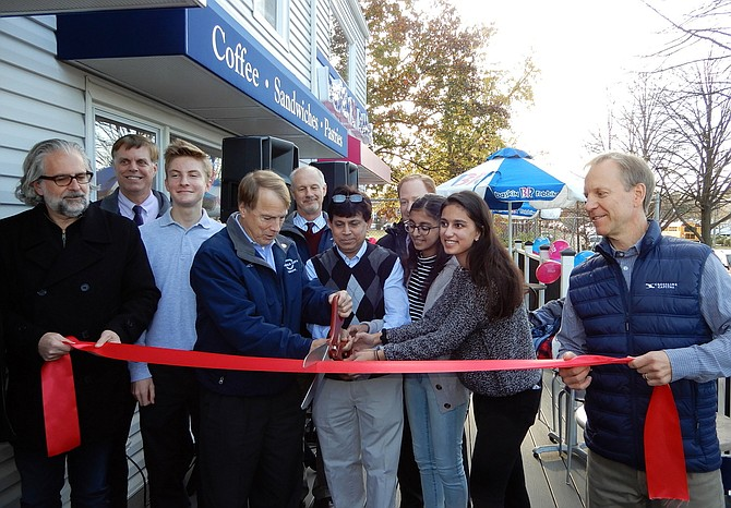 Participating in the ribbon-cutting are (from left) Michael DeMarco, Page Johnson, David Meyer, Tom Scibilia, Syed Ahmed and daughters Farjana and Syeda, and John Sabo.