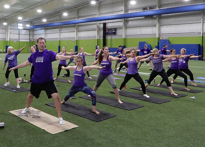 A yoga class at the Fieldhouse in Chantilly to raise money for Alzheimer's.