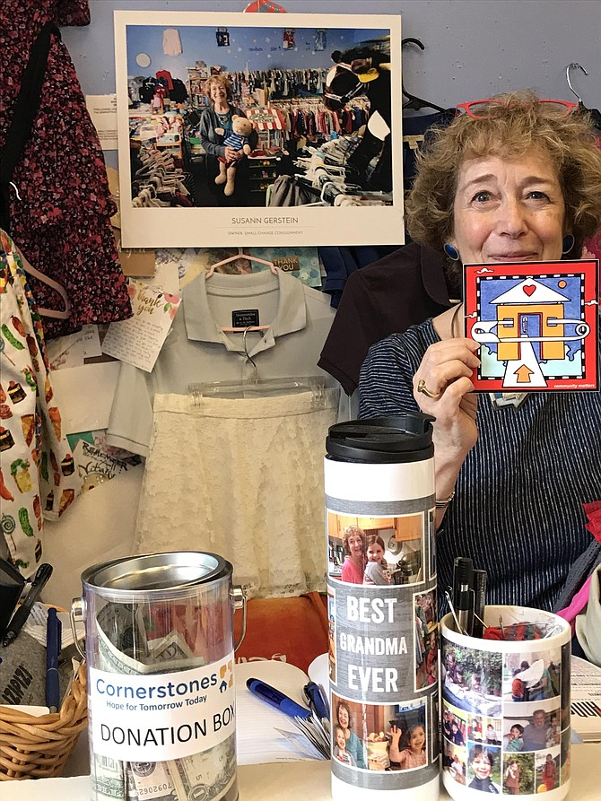 As owner Susann Gerstein prepares to close her shop, Small Change Consignment at Lake Anne Plaza in Reston, she stands behind its counter, with a watercolor painted and gifted to her by local artist, Dana Ann Scheurer, and an image of her in the shop taken by local photographer Charlotte Geary.