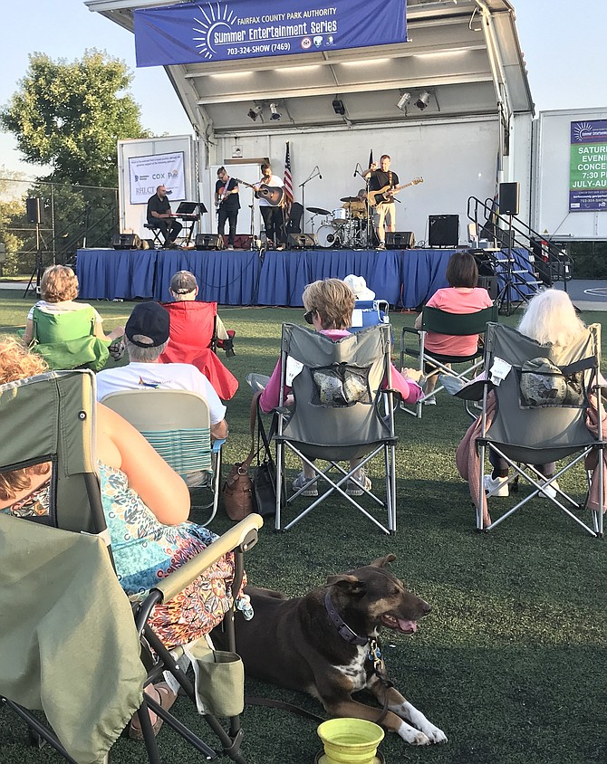 Patrons and pets enjoy the free concert open to the public featuring singer-songwriter Crys Mathews at the Fairfax County Park Authority Summer Entertainment Series held at Arrowbrook Centre Park in Herndon on Saturday, July 13.