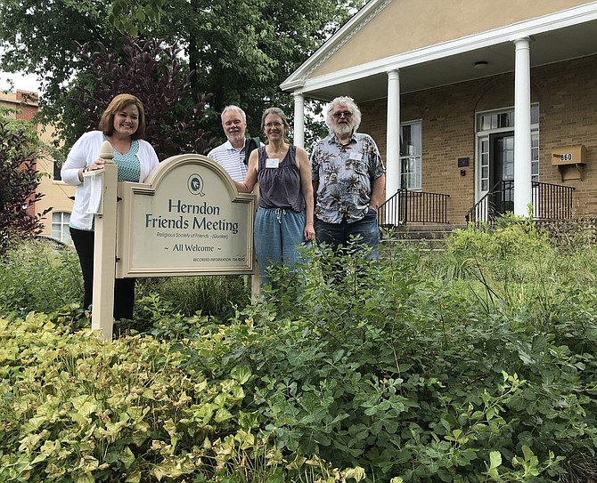 At Friends Meeting House in Herndon, worshippers Lea Wolf, Paul Murphy, Margaret Fisher and Tim McDermott stand beside one of the now thriving native gardens they and others planted late 2017. It adds form and function as it captures stormwater and infiltrates it into the soil rather than becoming runoff.