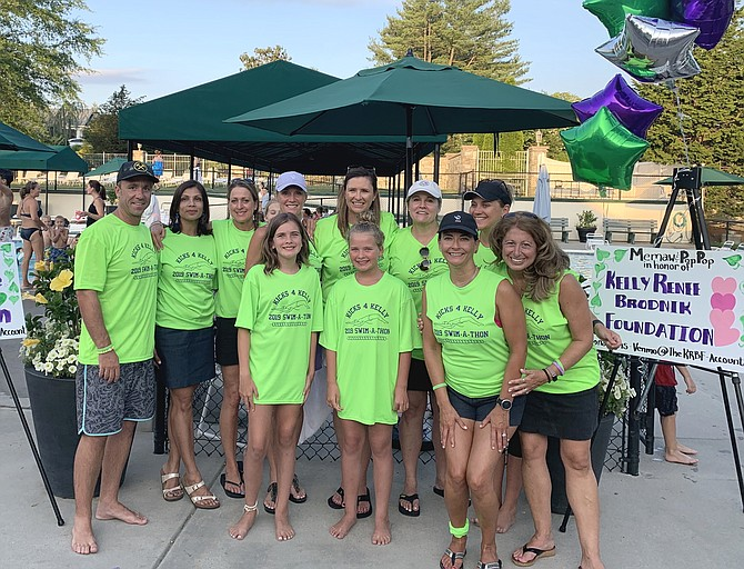 Swim team mothers and friends host first-ever Kicks for Kelly Swim-A-Thon bringing together Vienna community and supporting the Brodniks. Pictured, from left, top row: Head Coach Blair Piddington, Mona Hans, Carolyn Lynch, Kecia Harrell, Megan Wallace, Sally Payze, and Debbie Clapper); bottom row: Morgan Cunningham, Hayden Cunningham, Robin Bernhard, and Audra Hoebler.