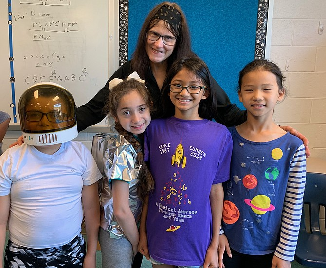 Instructor Ruth Donahue pictured with her students, Mateo Swartz, 10, Saba Akrami, 9, Oviyah Ramakrishnan, 9, and Alice Guo, 8 – all of McLean.