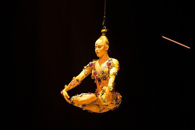 "Danila Bim, hair suspension artist in ""Volta"" from Cirque du Soleil."