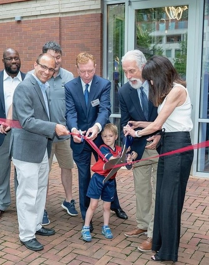 "Four-year-old Joe Blackburn, son of Home Grown Restaurant Group partner Bill Blackburn, helps cut the ribbon to formally open Whiskey & Oyster July 8 in the Carlyle District. Shown are City Councilman John Chapman, Mayor Justin Wilson, Bill Blackburn, Chamber of Commerce CEO Joe Haggerty, ""Mango"" Mike Anderson and Donna Anderson."