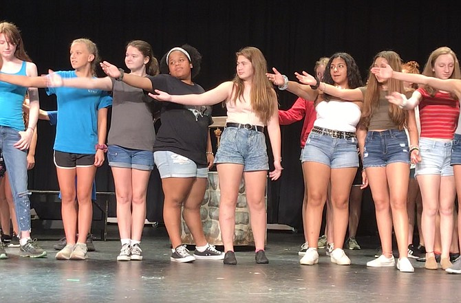 Summer Grand students rehearse Disney's Beauty and the Beast.