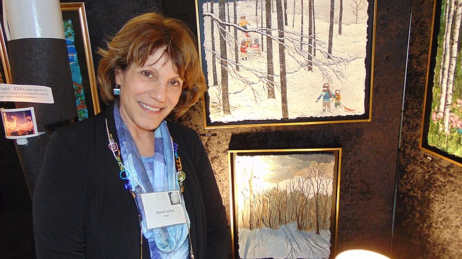 Ronni Jolles with her paintings with layered paper.
