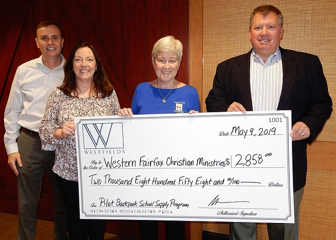 The check presentation: From left are CIC member Chuck Molina, Jennie Bush, Susan Ungerer and Bill Keech Jr.