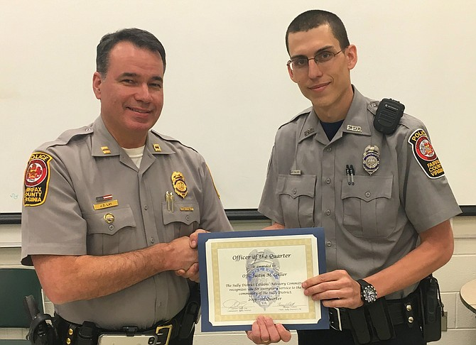 (From left) Capt. Dean Lay, Sully District Station commander, presents the Officer of the Quarter award to Officer Justin Collier.