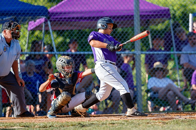 Luke Tilley (#44) hits a double in the top of the first inning to drive in Chantilly's only run.