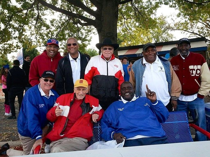 Petey Jones, standing second from right, with coaches and teammates of the '71 Titans football team at the 2015 50th anniversary of T.C. Williams High School. Jones died July 1 at the age of 65.