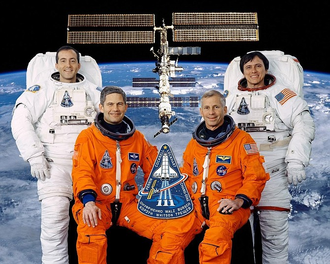 Alexandria businessman Paul Lockhart, second from left, as pilot of the crew of the Space Shuttle Endeavour in December of 2002. With him are Commander Kenneth Cockrell and Mission Specialists Franklin Chang-Diaz and Philippe Perrin.