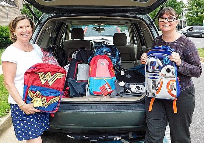 Unity of Fairfax Church collected $1,000 and 25 backpacks to support Britepaths' Collect for Kids program last year. From left, Nancy Schneider delivers backpacks and checks to Seasonal Programs Manager Joanne Walton.
