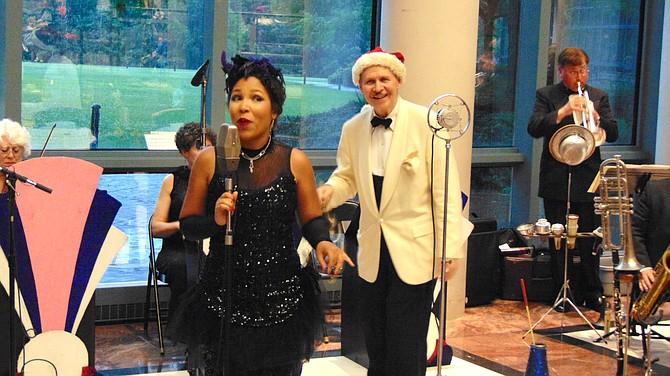 "Miss ""Moxie"" Lindsay Webb and Doc Scantlin perform during the Evenings on the Ellipse Summer Concert at the Fairfax County Government Center on Thursday, July 11, 2019."