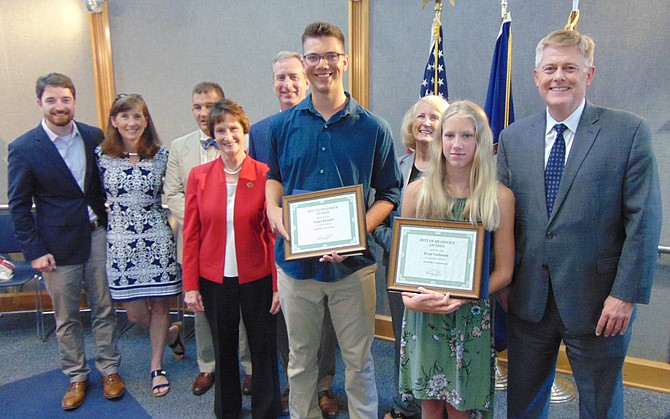 Winning Young Persons of the Year are James Kendall and Evyn VanBrunt with, from left, Alex Robbins representing U.S. Rep. Gerry Connolly's office; Megan McLaughlin, School Board member from the Braddock District; State Sen. Chap Peterson (D-34); Sharon Bulova, Chairman of the Board of Supervisors; Del. David Bulova (D-37); Del. Vivian Watts (D-39); and Braddock District Supervisor John C. Cook.