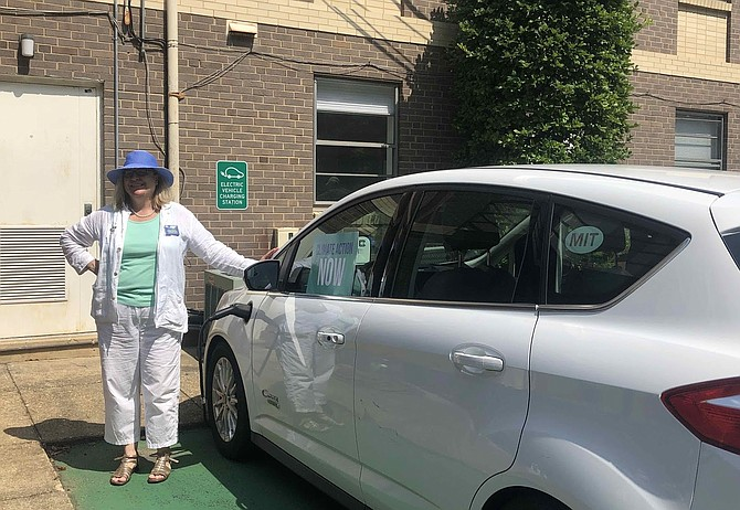 Andrea McGimsey charges her plug-in hybrid electric vehicle at Daniels Run Peace Church.