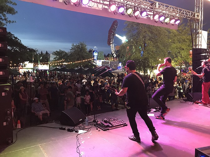 """Ocho de Bastos,"" the Latin pop band, 'unites the people through music' at the 2019 Herndon Festival."