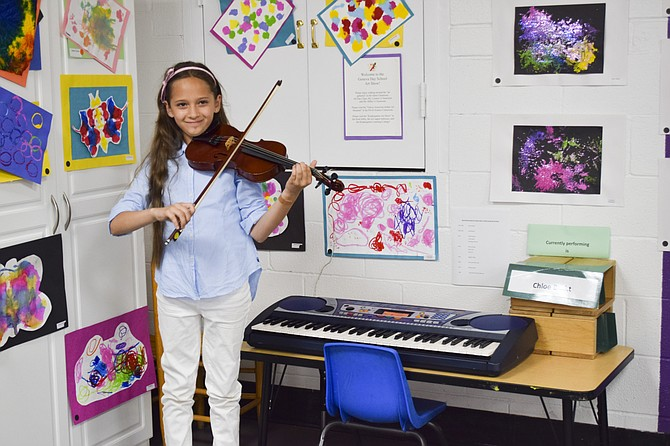 Geneva Alum Chloe Brokt, a 10 year-old violinist from Stone Ridge, traced love of her instrument to her earliest exposure to music at Geneva.