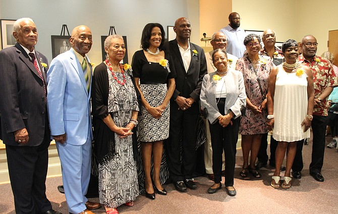 "Eleven African American Living Legends of Alexandria pose for a photo at a reception at the Black History Museum. From left are: Lawrence ""Robbie"" Robinson, James Henson, Lillian Stanton Patterson, Florence King, Ronal Butler, Joyce Rawlings, Bill Cleveland, Ruth Cleveland, Lynnwood Campbell, Ramona Hatten, and William ""Bill"" Euille."
