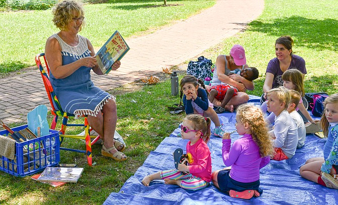 Nancy Bronez of Vienna reads dog-themed books for last week's stories, songs and sprinklers edition.