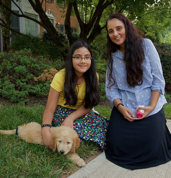 Sahaj and Navjyot Chahal with their puppy, Mochi, an 8-week-old Goldendoodle that they just picked up last week. Mochi is very soft and friendly, and is trying to figure this whole thing out.