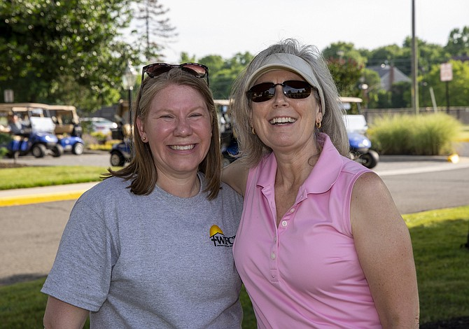 From left, WFCM's Harmonie Taddeo and the Rev. Lynn Miller of King of Kings Lutheran Church. Miller golfed and gave the blessing at the event.