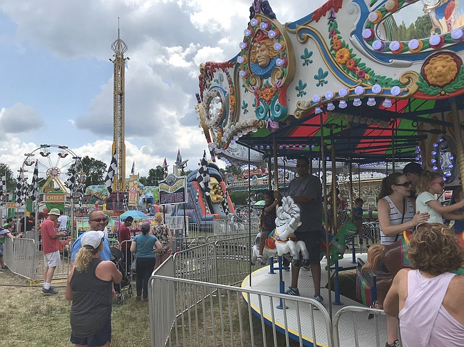 The whirl and twirl of rides by Cole Shows Amusement Company attracted crowds during Fairfax County's 71st 4-H Fair and Carnival, held at Frying Pan Park in Herndon.