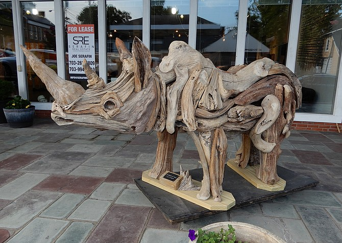 Larry Ringgold created this rhinoceros out of driftwood. When it's outside, it means the art gallery is open.
