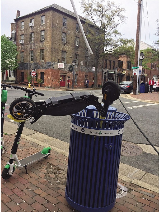 Scooter dumped in Old Town recycling bin.