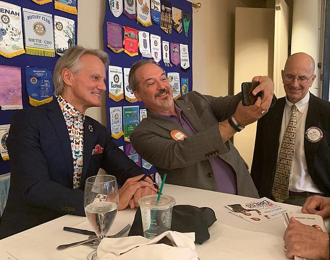 Monte Durham, left, poses for a selfie with Derek Mason as Jack Fannon looks on. Durham was on hand at the Alexandria Rotary Club meeting Aug. 6 at Belle Haven Country Club.
