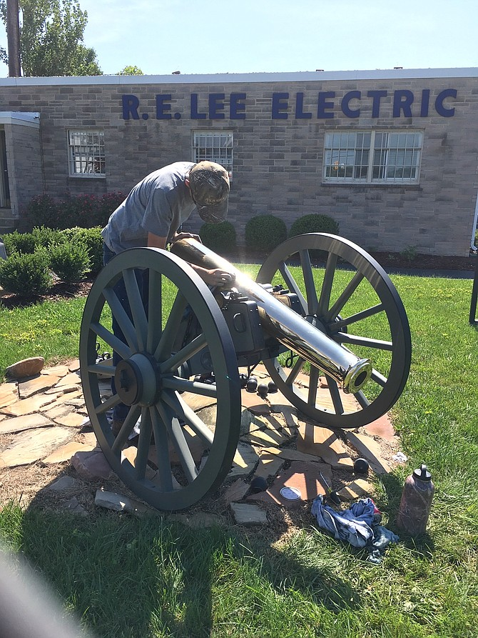 Edison High School rising senior David Finell shines up the cannon at R.E. Lee Electric in Newington.