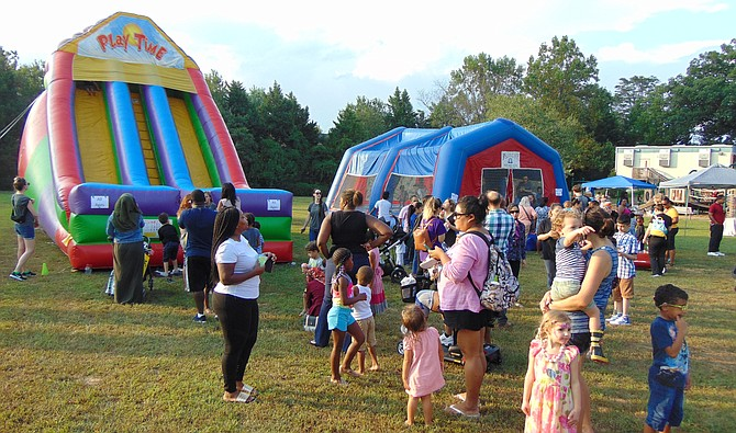 The lines for the Inflatable rides during National Night Out in Lorton.