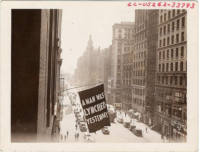Flag, announcing lynching, flown from the window of the NAACP headquarters on 69 Fifth Ave., New York City.