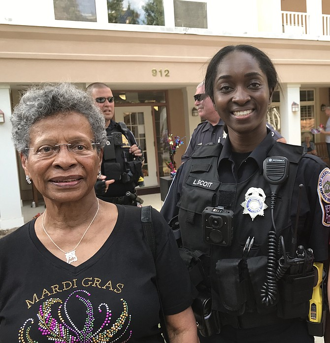 Herndon Harbor House resident Imes Bello greets the newest member of the Herndon Police Department, Officer L. Scott.