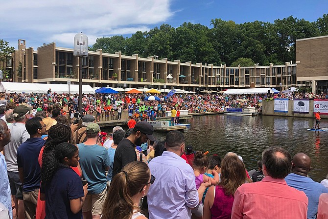 More than 3,000 people pack Lake Anne Plaza to watch the largest Cardboard Boat Regatta held there.