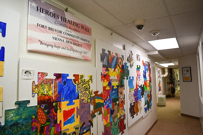 """The Healing Wall"" and ""The Open Door"" exhibits are located on the lower level of the building."