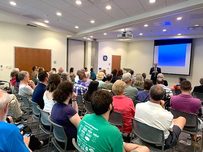 David Robarge, the chief historian of the CIA, talking in front of an audience at the Shirlington Branch Library on July 29.