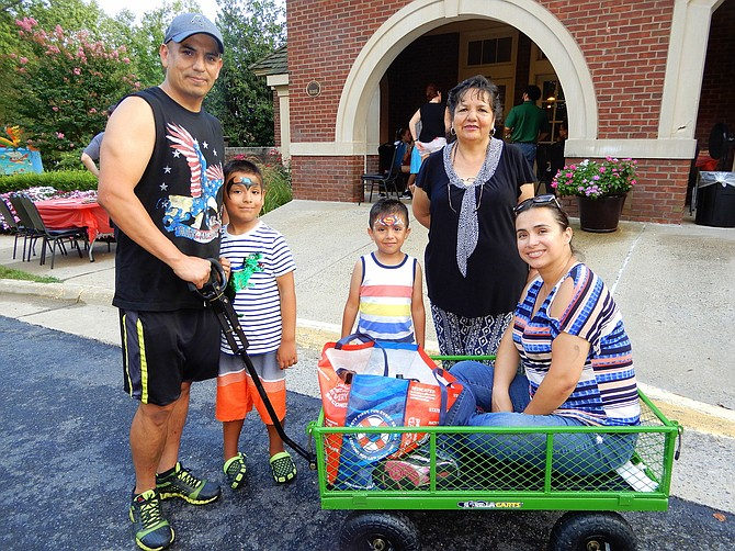 Having fun at Sully Station are (from left) Alex Calancha, sons Christopher, 6, and Anthony, 4, Calancha's mother Lourdes and his wife Veronica.