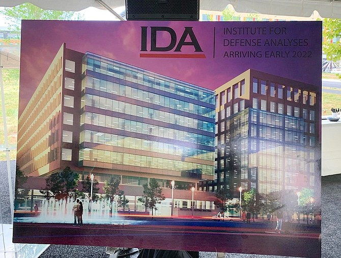 An architectural rendering of the Northeast view of the planned IDA headquarters on display during the Aug. 13 groundbreaking at Potomac Yard.
