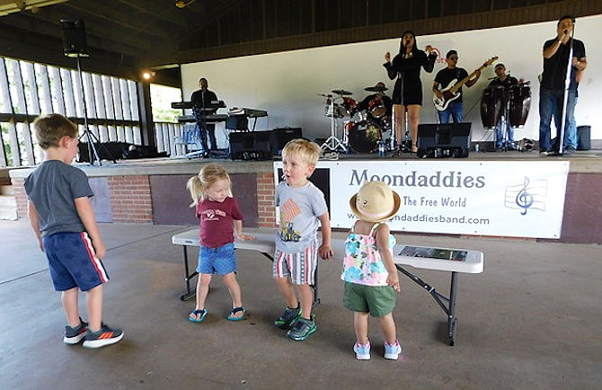 Children enjoy dancing to Moondaddies.