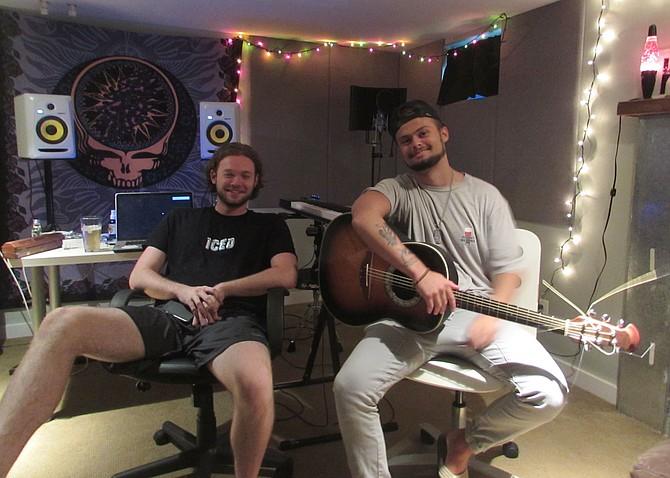 Zach Siegel (left) and George Hughes in their basement studio.