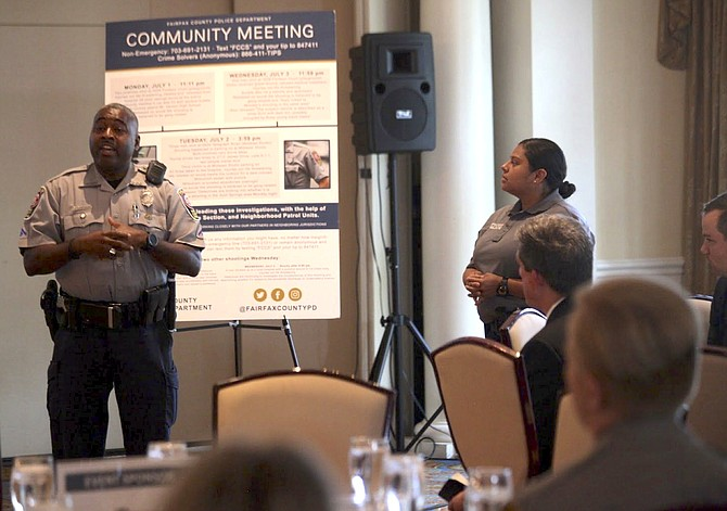 Officer Marvin Goodley of Mount Vernon Police Station (left) discusses the safety programs the station offers for business owners.