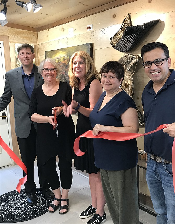 From left, Dennis Holste, Economic Development Manager, Town of Herndon; Dorian Traynham, owner of STUDIO 797; and Herndon Town Councilmembers Jennifer Baker, Signe Friedrichs and Pradip Dhakal at the ribbon cutting ceremony.