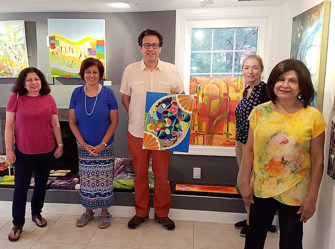 The E Street Artists will host an exhibit of their art at Glen Echo Park this weekend, Aug. 24 and 25. Shown from left are Feriel BenSalem, Sabhia Iqbal, Guillermo Munoz, Jasmin Smith and Nimi Trehan.