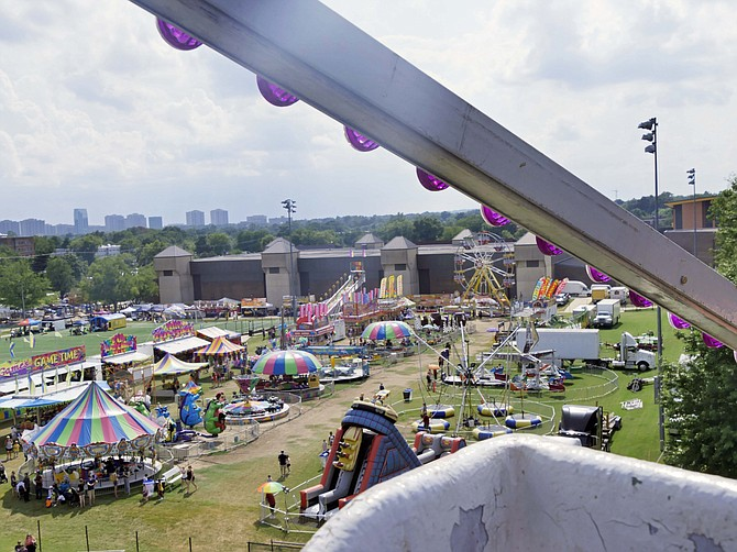 The fairground is spread out below before the riders at the top of the Ferris wheel on Friday, Aug. 16 at the Arlington County Fair.