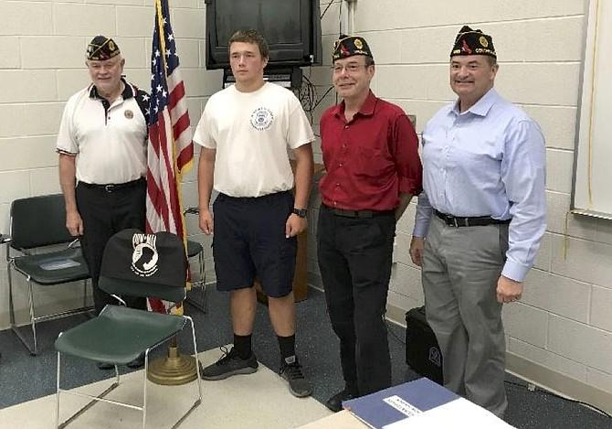 From left: Post Commander Steve Hunter, Russell Desrosier,  Sergeant-at-Arms Mark Miller, and member Warren Benson.