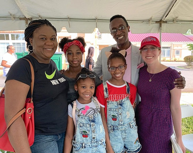 Rosemary Anyanwu, left, with daughters Ruth, Denise and Rachel, pose for a photo with Hopkins House President Glenn Hopkins and Alexandria Vice Mayor Elizabeth Bennett-Parker at the 80th anniversary Founding Day celebration Aug. 10 at the Hopkins House campus on Richmond Highway.