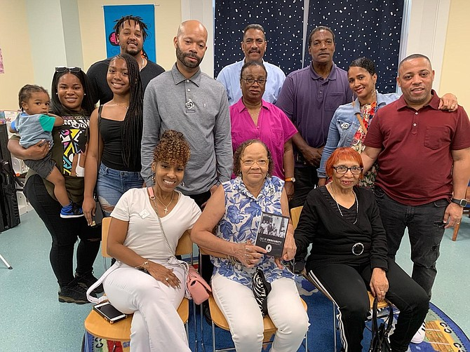 """Four generations of the William """"Buddy"""" Evans family gather at the Barrett Branch Library on Aug. 19 to commemorate the 80th anniversary of the 1939 Alexandria Library Sit-In. Seated in front are Evans' daughters Joyce Angela Evans Jackson, center, and Beverly Wanzer, right, surrounded by children, grandchildren, great-grandchildren and a great-great grandchild."""