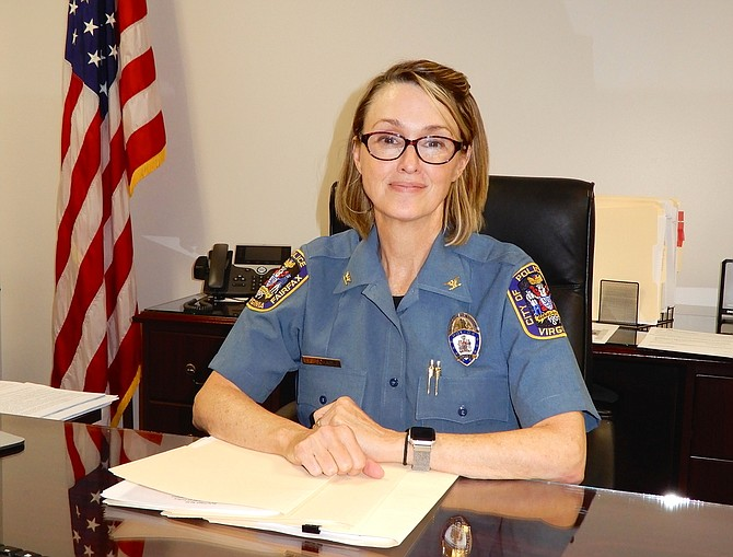 Police Chief Erin Schaible at her desk in Fairfax City's police station.