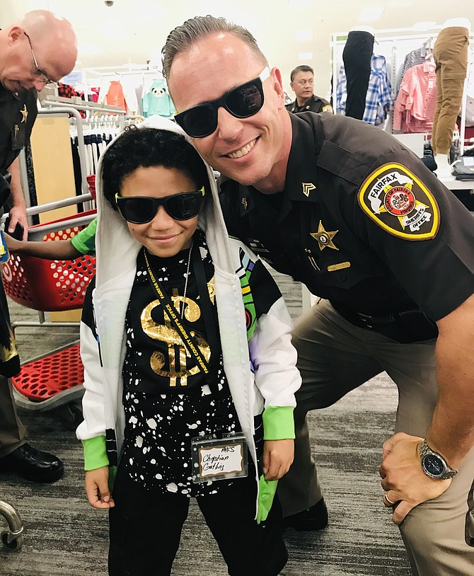 Two cool dudes, Sergeant C. M. Loftis, Public Information Officer for Fairfax County Sheriff's Office, and Christian Gatling don their shades as they go back-to-school shopping together at Target in Burke during the 2019 Shop with the Sheriff Program.